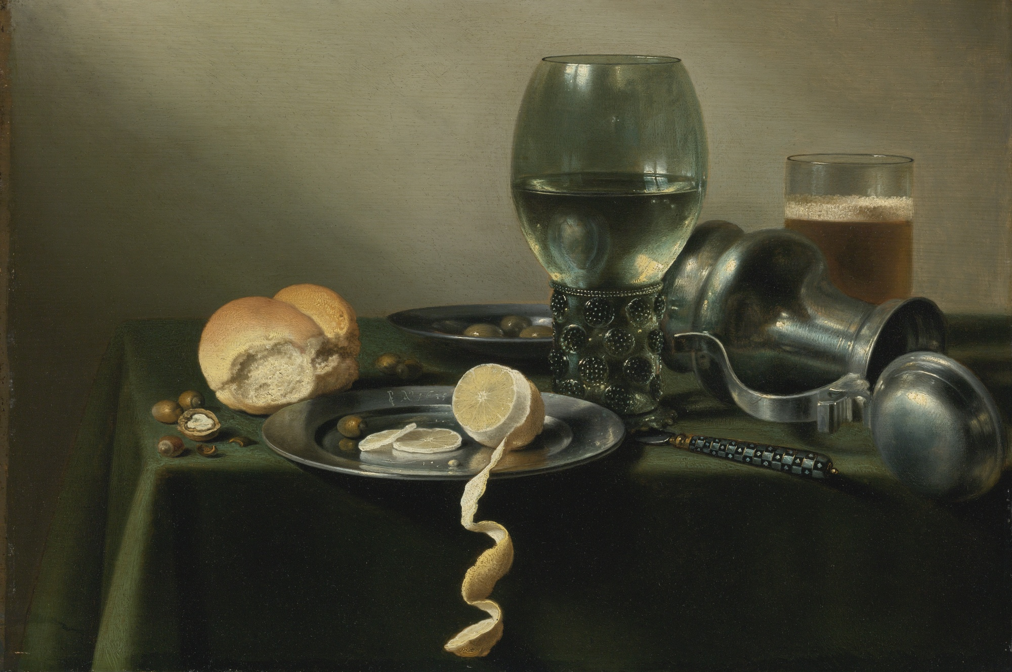 A Roemer Glass, Overturned Pewter Jug, Olives, and a Half-Peeled Lemon on Pewter Plates, by Pieter Claesz, 1635